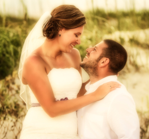 Intimate images of couple on beach afger wedding